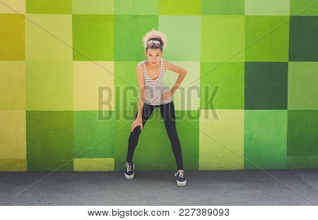 Pensive African-american Woman Standing At Bright Graffiti Wall, Relaxing From Jog Training, Copy Sp