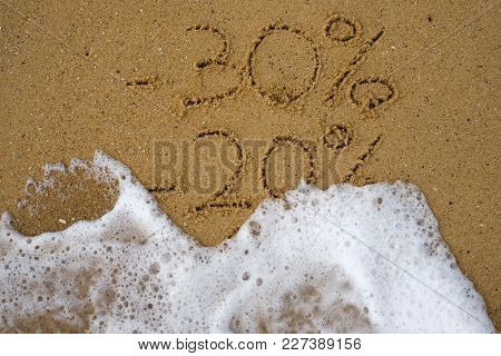 Sale Percents Drawn On Sand. Water Moving Text Away