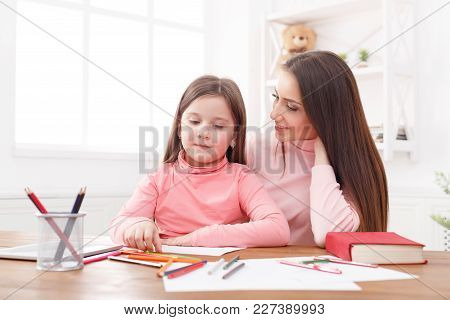 Mother Drawing With Her Daughter. Relationship, Motherhood, Joint Activities And Interests, Trust, S