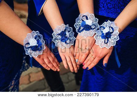 Hands Bridesmaids Close-up In Blue Dresses With Decorated Bracelets