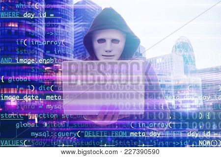 Double exposure of hacker using laptop, code and cityscape view. Concept of cyber attack and security