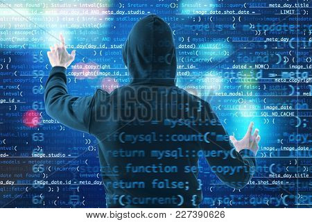 Hacker working with code on virtual screen. Concept of cyber attack and security