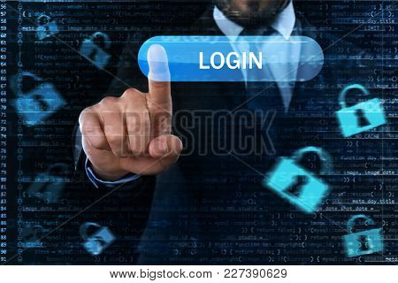 Businessman pushing login button on virtual screen against dark background. Concept of cyber attack and security