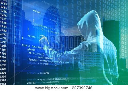 Double exposure of hacker working with code on virtual screen and cityscape view. Concept of cyber attack and security