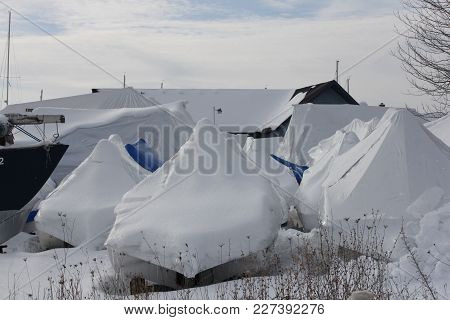 Plastic Shrink Wrap On Boats, To Protect Boats And Interior Of Boats From The Winter Elements.