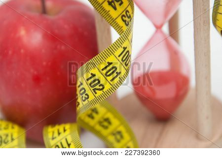 Lose Weight Concept. Red Apple And Tape Measure Close Up. Fat Burning