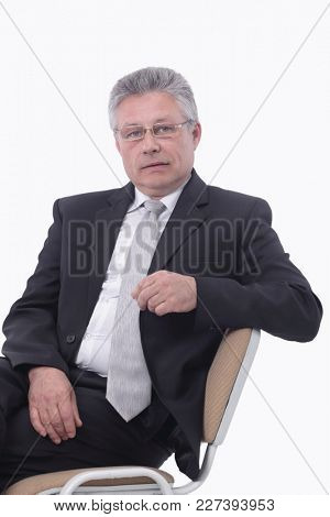 Handsome caucasian man businessman sitting relaxed