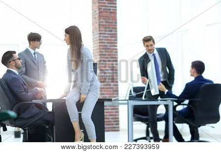Business people discussing over new business project in office.