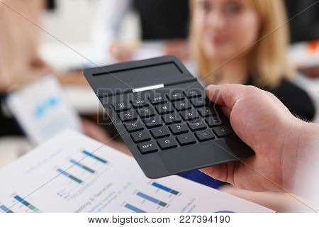 Male Hand Holding Calculator At Office Worker People Closeup. Internal Revenue Service Inspector Sum