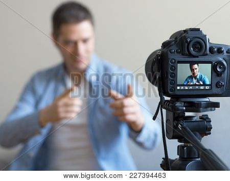Handsome Man Making Video Blog. Focus On Camera.
