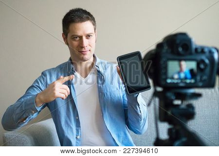 Handsome Man Making Video Blog About Tablet Pc.