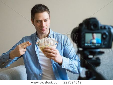 Handsome Man Making Video Blog About Money Earning.