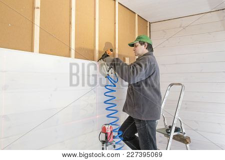 Construction Worker Thermally Insulating Eco Wooden Frame House With Wood Fiber Plates. Finishing Th