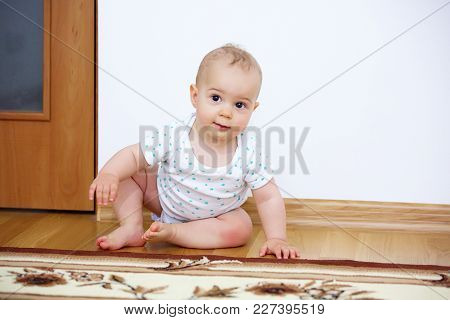 Adorable Baby Boy Playing In Badroom In Sunny Day.