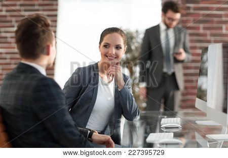 active young woman employee in the office