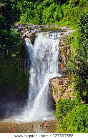 Tegenungan Waterfall on Bali island Indonesia - travel and nature background