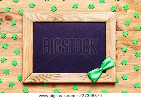 St Patricks Day Background. Wooden Frame With Green Bow Tie And Space For St Patricks Day Text And G