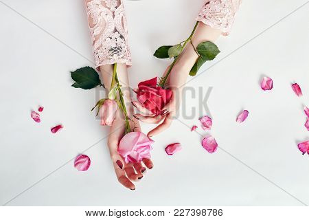 Fashion Art Portrait Woman In Summer Dress And Flowers In Her Hand With A Bright Contrasting Makeup.