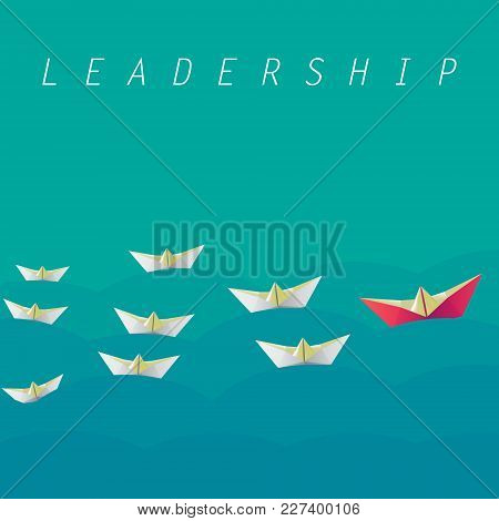 Leadership Concept. One Red Leader Boat Lead Other White Boats Forward. Red And White Paper Boats. T