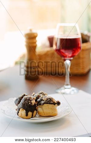 Dessert Beverage With The Chocolate At The Top And Glass Of Red Wine