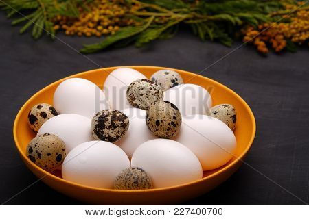 Easter Table Setting With White Eggs With Mimosa Flower Selective Focus Image. Happy Easter