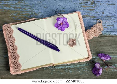 Women's Notebook And Pen On The Table