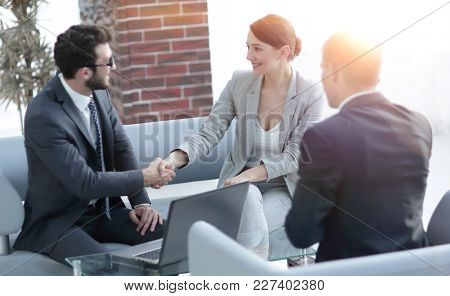 business handshake women with the client