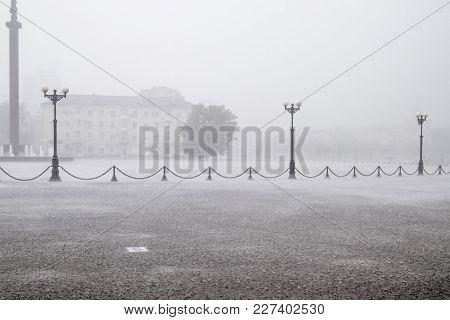 A Heavy Rain On The Embankment Of Novorossiysk. Heavy Rain.