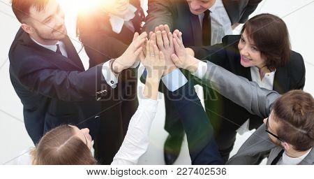 closeup. joyful business team with folded hands together