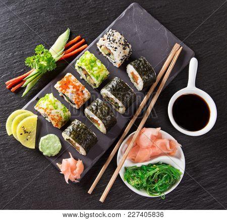 Japanese Sushi over black background, close-up.