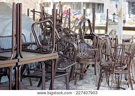 Stack Of Metal Brown Chairs And Tables In Closed Coffee Shop