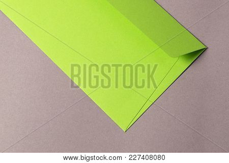 Green Envelope On The Grey Background With Copy Space For Your Message