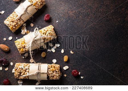 Granola Bars. Fruit And Grain Granola Bars On Dark Stone Table. Top View With Copy Space.