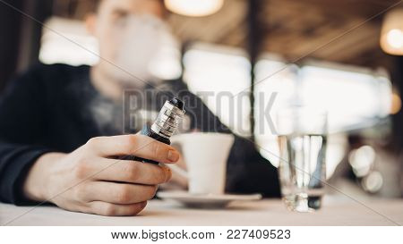 Using Electronic Cigarette To Smoke In Public Places.smoke Restriction,smoking Ban.using Vaping Devi