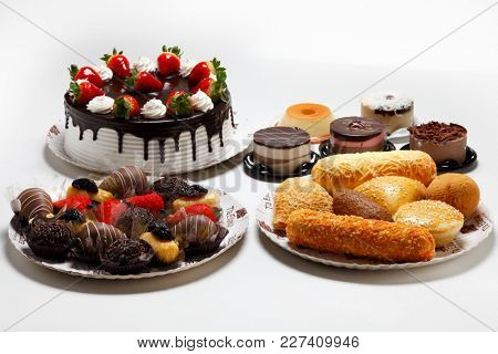 Table with chocolate cake, savory and sweet