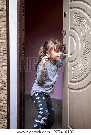A Little Girl Opens The Door Of His Apartment And Goes Home.