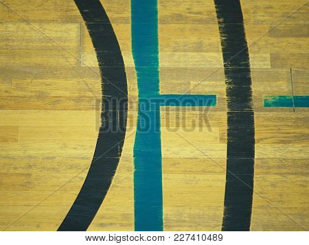 Play Field Markings On The Floor In The Gym. Worn Out Wooden Floor In School Sporting Hall.