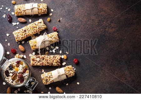 Granola Bars. Fruit And Grain Granola Bars On Dark Stone Table. Top View With Copy Space. Diet Food,