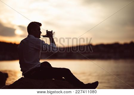 Young Stressed Business Man Drinking Wine Alone.alcoholic Man Unhappy With His Life,addicted To Alco