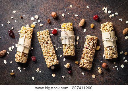 Granola Bars. Fruit And Grain Granola Bars On Dark Stone Table. Top View.