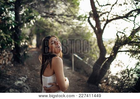 Romantic Woman Enjoying Walk In The Nature On A Sunny Morning.mindful Carefree Female In Natural Env