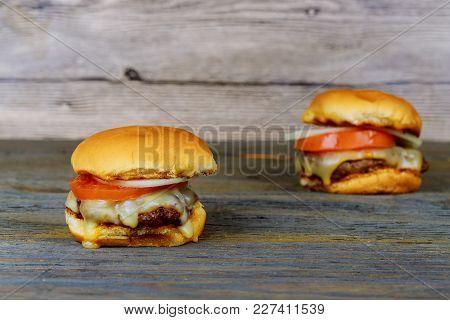 Homemade Hamburger Big Delicious Hamburger On A Cutting Board, Rustic Table