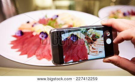 Hands Taking Picture Of Sashimi Japan Food With Smartphone