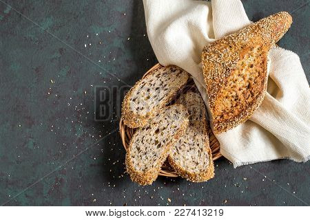 Freshly Baked Homemade Whole Wheat Bread With Flaxseeds (whole And Slices) On Linen Napkin. Useful D