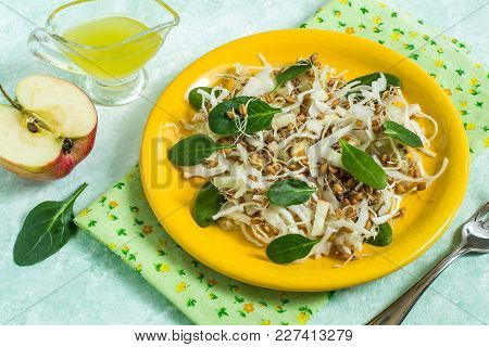 Fresh Vegetarian Salad With Sprouted Wheat, Cabbage, Apple And Spinach On Yellow Plate. Dressed With