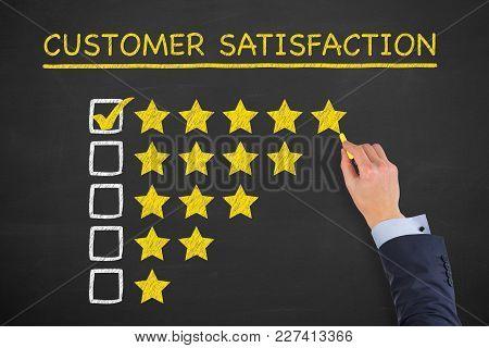 Human Hand Drawing Customer Satisfaction On Chalkboard Background