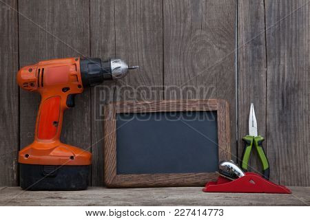 Working tools on wooden rustic background.