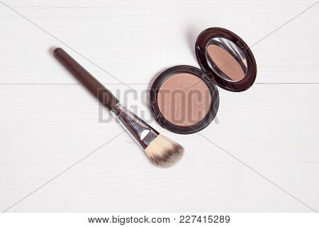 Professional Makeup Brush With Sculptor On White Wooden Background.