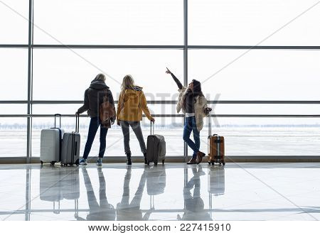 Calm Girls Waiting For Boarding Near Departure Gate. They Are Observing Planes From Window. Copy Spa