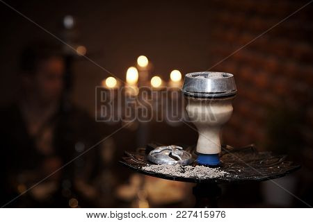 Bowl Of Hookah With Ash And Coals Close-up On A Blurred Background